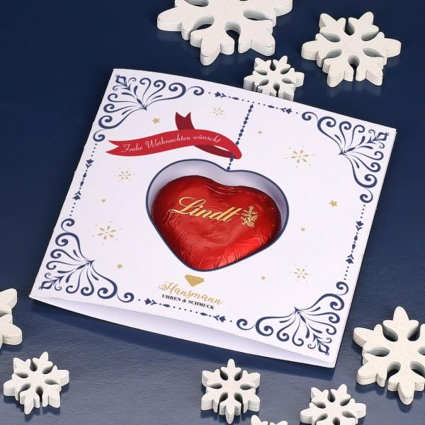 Klappkarte zu Weihnachten mit rotem Lindt-Herz und Firmenlogo