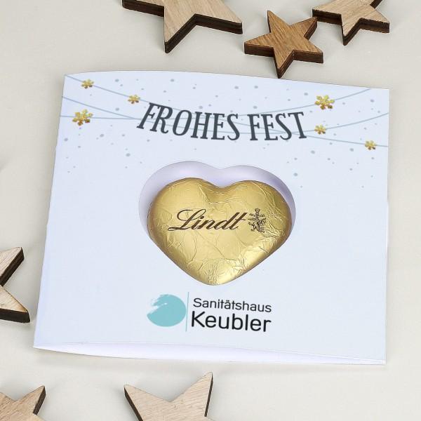 """Klappkarte """"Frohes Fest"""" mit Lindt Schoko Herz und Firmenlogo"""