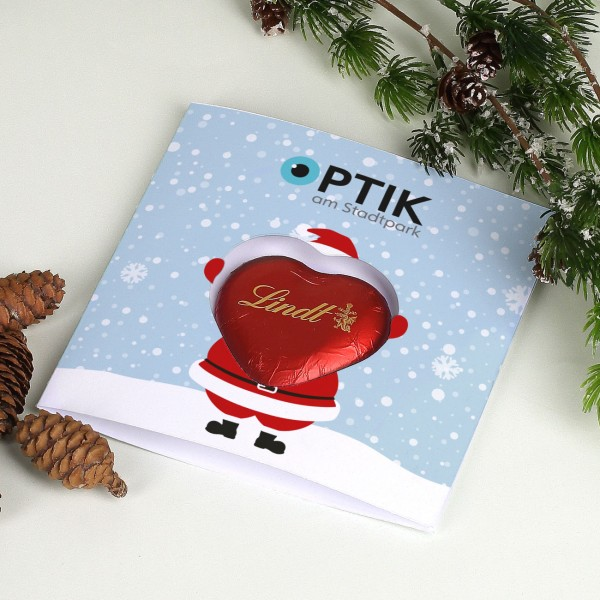 Geschäftliche Weihnachtskarte mit Weihnachtsmann und Lindt Schoko Herz