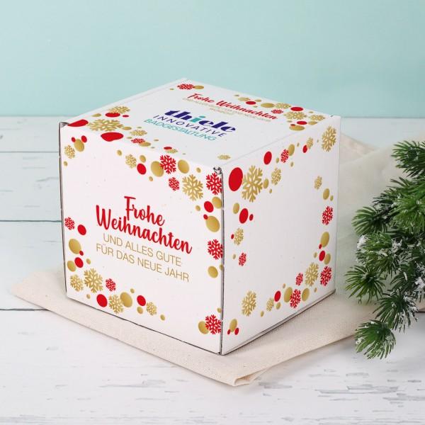 Tassenverpackung mit weihnachtlichen Motiv und Firmenlogo
